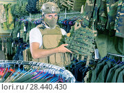 Купить «Male customer try on ammunition with rifle», фото № 28440430, снято 4 июля 2017 г. (c) Яков Филимонов / Фотобанк Лори