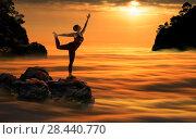 Купить «Женщина выполняет  упражнения йоги над облаками на фоне красивого заката», фото № 28440770, снято 30 апреля 2018 г. (c) Владимир Мельников / Фотобанк Лори