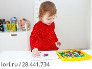 Купить «Little 2 years girl plays with mosaic at home», фото № 28441734, снято 6 февраля 2018 г. (c) ivolodina / Фотобанк Лори