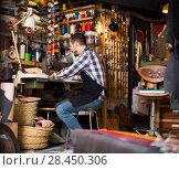 Купить «male worker sewing stitches on belt in leather workshop», фото № 28450306, снято 22 марта 2019 г. (c) Яков Филимонов / Фотобанк Лори