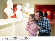 Купить «Positive father and daughter exploring statues», фото № 28450354, снято 18 июля 2018 г. (c) Яков Филимонов / Фотобанк Лори