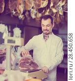 Купить «Positive assistant weighing on scales piece of meat», фото № 28450658, снято 2 января 2017 г. (c) Яков Филимонов / Фотобанк Лори