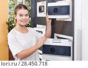 Купить «Attractive girl looking for reliable home safe», фото № 28450718, снято 17 апреля 2018 г. (c) Яков Филимонов / Фотобанк Лори