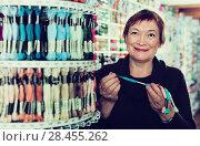 Купить «Woman choosing mouline for embroidery in needlework shop», фото № 28455262, снято 10 мая 2017 г. (c) Яков Филимонов / Фотобанк Лори