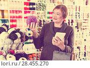 Купить «Woman with shopping bags using phone», фото № 28455270, снято 10 мая 2017 г. (c) Яков Филимонов / Фотобанк Лори