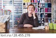 Купить «Positive saleswoman waiting for clients in store», фото № 28455278, снято 10 мая 2017 г. (c) Яков Филимонов / Фотобанк Лори
