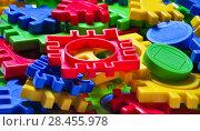 Купить «Детский разноцветный пластмассовый пазл-конструктор. Фон», фото № 28455978, снято 25 января 2018 г. (c) Алёшина Оксана / Фотобанк Лори