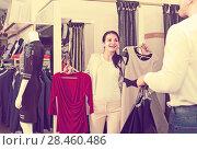 Купить «Ordinary couple purchasing dress and blouse», фото № 28460486, снято 24 октября 2016 г. (c) Яков Филимонов / Фотобанк Лори