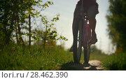 Купить «Green tree branches, girls walking on bicycles, green tree, sunny summer day», видеоролик № 28462390, снято 20 ноября 2019 г. (c) Константин Шишкин / Фотобанк Лори
