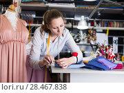 Купить «Woman professional sewer sew up textile at sewing atelier», фото № 28467838, снято 5 мая 2018 г. (c) Яков Филимонов / Фотобанк Лори