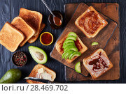 Купить «toasts with butter, avocado and yeast spread», фото № 28469702, снято 13 мая 2018 г. (c) Oksana Zh / Фотобанк Лори