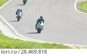 Купить «Motorcycle competitions, turn to the right, slow motion», видеоролик № 28469818, снято 20 сентября 2018 г. (c) Константин Шишкин / Фотобанк Лори