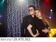 Купить «couple of dancing people at a disco», фото № 28470362, снято 10 марта 2018 г. (c) Типляшина Евгения / Фотобанк Лори