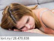 Купить «sad female on cozy sofa at home», фото № 28470838, снято 31 марта 2020 г. (c) Яков Филимонов / Фотобанк Лори