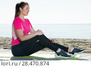 Купить «Woman relaxing after workout outdoors», фото № 28470874, снято 8 мая 2017 г. (c) Яков Филимонов / Фотобанк Лори