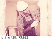 Купить «Adult man constructor with circular saw», фото № 28475922, снято 18 мая 2017 г. (c) Яков Филимонов / Фотобанк Лори