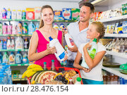 Купить «Cheerful people showing household goods purchase», фото № 28476154, снято 11 июля 2017 г. (c) Яков Филимонов / Фотобанк Лори