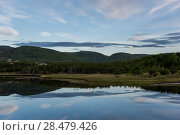 Купить «Scenic view of river with mountains in background, Margaree River, Cabot Trail, Cape Breton Island, Nova Scotia, Canada», фото № 28479426, снято 11 июня 2016 г. (c) Ingram Publishing / Фотобанк Лори