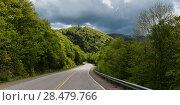 Купить «Empty road amidst trees by hills, Pleasant Bay, Cape Breton Highlands National Park, Cape Breton Island, Nova Scotia, Canada», фото № 28479766, снято 12 июня 2016 г. (c) Ingram Publishing / Фотобанк Лори