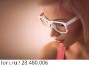 Купить «Beautiful young blond girl with short hair wearing glasses in pink style», фото № 28480006, снято 18 января 2014 г. (c) Ingram Publishing / Фотобанк Лори