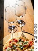 Купить «Close up picture of empty wineglasses and fresh baked pizza at home», фото № 28480086, снято 15 декабря 2018 г. (c) Ingram Publishing / Фотобанк Лори