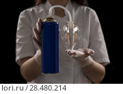 Купить «Unrecognizable female doctor holding can with oxygen and breathing through the mask», фото № 28480214, снято 16 мая 2014 г. (c) Ingram Publishing / Фотобанк Лори