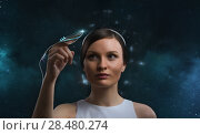 Купить «People of the future. Pretty woman against cosmic background», фото № 28480274, снято 17 мая 2014 г. (c) Ingram Publishing / Фотобанк Лори