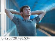 Купить «Attractive fit young man stretching before exercise, sunrise early morning backlit. Shallow depth of field», фото № 28480534, снято 22 июня 2014 г. (c) Ingram Publishing / Фотобанк Лори