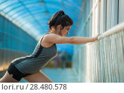 Купить «Fit young woman stretching before a run. Young female runner stretching her muscles before a training session», фото № 28480578, снято 22 июня 2014 г. (c) Ingram Publishing / Фотобанк Лори