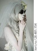 Купить «Halloween witch. Beautiful woman wearing santa muerte mask and wedding dress», фото № 28481154, снято 21 сентября 2014 г. (c) Ingram Publishing / Фотобанк Лори