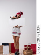 Купить «Christmas woman hold big white card copyspace. Winter knitted beanie hat. Full length.», фото № 28481334, снято 15 октября 2014 г. (c) Ingram Publishing / Фотобанк Лори