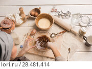 Купить «Woman baking Christmas cookies in her kitchen. Top view», фото № 28481414, снято 15 октября 2014 г. (c) Ingram Publishing / Фотобанк Лори