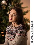 Купить «Beautiful woman wearing winter outfit sitting on couch at home near Christmas tree», фото № 28481638, снято 12 ноября 2014 г. (c) Ingram Publishing / Фотобанк Лори
