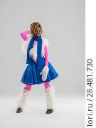 Купить «Festive african woman wearing funny costume posing on gray background», фото № 28481730, снято 13 ноября 2014 г. (c) Ingram Publishing / Фотобанк Лори