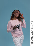 Купить «Beautiful young african woman using camera and photographing on blue background», фото № 28481778, снято 19 ноября 2014 г. (c) Ingram Publishing / Фотобанк Лори