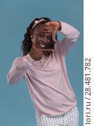 Купить «Beautiful young african woman framing photograph on blue background», фото № 28481782, снято 19 ноября 2014 г. (c) Ingram Publishing / Фотобанк Лори