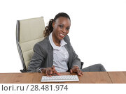 Купить «African business woman sitting at her desk and working isolated on white background», фото № 28481974, снято 19 ноября 2014 г. (c) Ingram Publishing / Фотобанк Лори