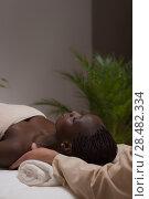 Купить «Portrait of young beautiful african woman in spa environment getting massage», фото № 28482334, снято 19 ноября 2014 г. (c) Ingram Publishing / Фотобанк Лори