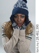 Купить «Portrait of african woman on gray background wearing woolen accessories», фото № 28482390, снято 20 ноября 2014 г. (c) Ingram Publishing / Фотобанк Лори