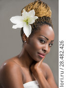 Купить «Portrait of a sensual young African woman with lily flower in hair», фото № 28482426, снято 20 ноября 2014 г. (c) Ingram Publishing / Фотобанк Лори
