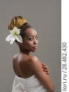 Купить «Portrait of a sensual young African woman with lily flower in hair», фото № 28482430, снято 20 ноября 2014 г. (c) Ingram Publishing / Фотобанк Лори