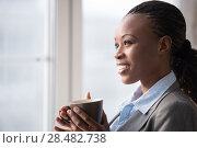 Купить «Candid image of a businesswoman drinking coffee while working at office. Selective focus.», фото № 28482738, снято 1 декабря 2014 г. (c) Ingram Publishing / Фотобанк Лори