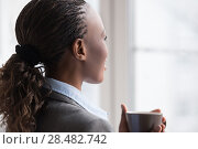 Купить «Candid image of a businesswoman drinking coffee while working at office. Selective focus.», фото № 28482742, снято 1 декабря 2014 г. (c) Ingram Publishing / Фотобанк Лори