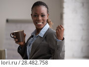 Купить «Candid image of a businesswoman drinking coffee while working at office. Selective focus.», фото № 28482758, снято 1 декабря 2014 г. (c) Ingram Publishing / Фотобанк Лори