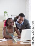 Купить «Young african business women in office working together on laptop», фото № 28482770, снято 1 декабря 2014 г. (c) Ingram Publishing / Фотобанк Лори