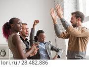 Купить «Business team celebrating a good job in the office», фото № 28482886, снято 1 декабря 2014 г. (c) Ingram Publishing / Фотобанк Лори