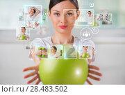 Sporty woman working out using modern virtual interface. Стоковое фото, фотограф Kirill Kedrinskiy / Ingram Publishing / Фотобанк Лори