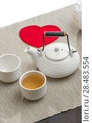 Valentine's day surprice for couple. Romantic tea set with red heart. Стоковое фото, фотограф Kirill Kedrinskiy / Ingram Publishing / Фотобанк Лори