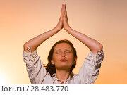 Купить «Yoga against the orange sky», фото № 28483770, снято 22 июня 2013 г. (c) Ingram Publishing / Фотобанк Лори