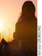 Купить «Beautiful Yoga woman siting against sunrise and rays of sun surrounding her», фото № 28483942, снято 22 июня 2013 г. (c) Ingram Publishing / Фотобанк Лори